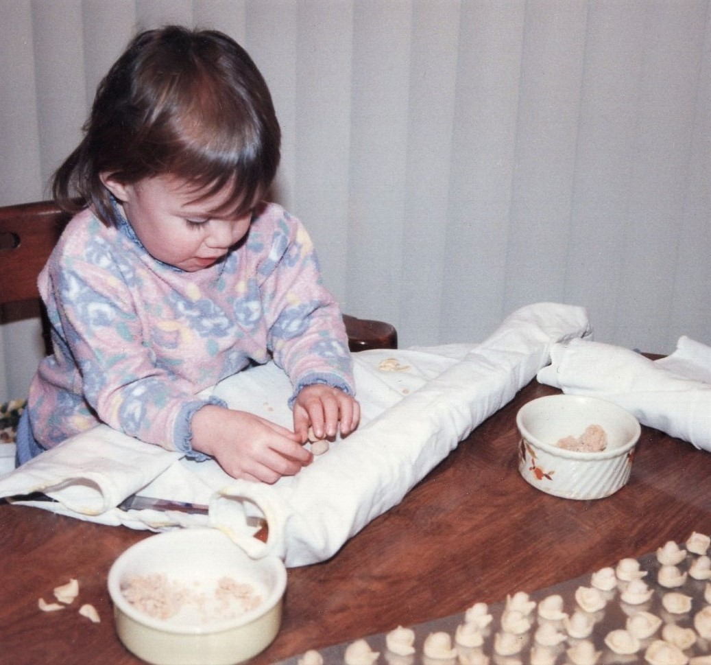 Making homemade tortellini as a child.